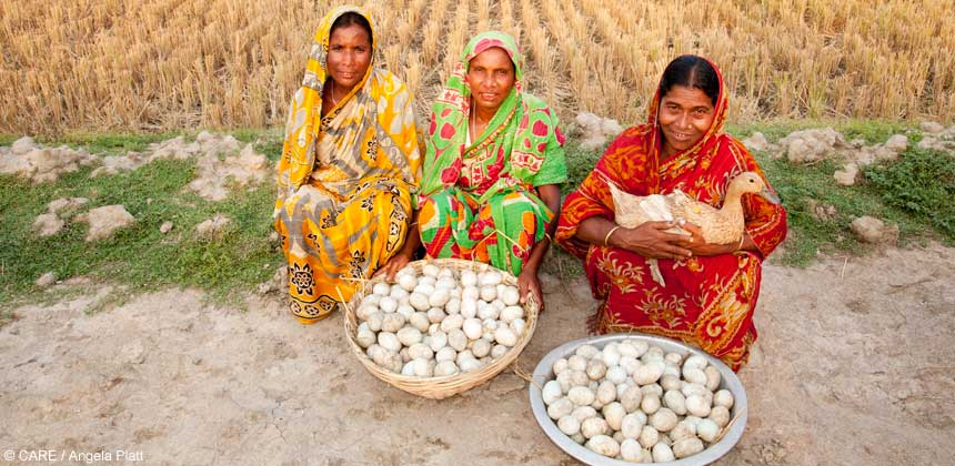 Women displaying baskets of duck eggs